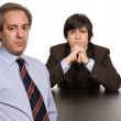 Two business men boss and worker on a desk — Stock Photo