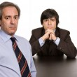 Two business men boss and worker on a desk — Stock Photo #23628685