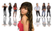 Beautiful young girl in front of a group of — Stock Photo