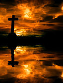 Cross silhouette and the clouds at sunset — Stock Photo