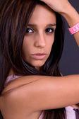 Young beautiful brunette portrait against black background — Stock Photo