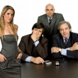 Woman boss and a group of workers on a desk — Stock Photo #23676433