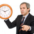Mature handsome business mholding clock — Stock Photo #23677383