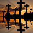 Cross at the sunset and the orange clouds — Stock Photo