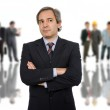 Business man in front of a group of — Stock Photo #23678939