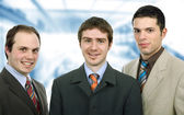 Three happy business men together as a team — Stock Photo