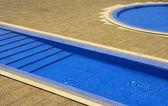 Swimming pool blue water in a summer day — Stock Photo