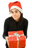 Beautiful young girl holding a christmas gift — Stockfoto
