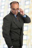 Mature business man thinking taking off his glasses — Stock Photo