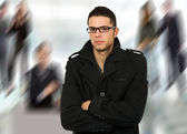 Young casual man portrait standing very bored — Stock Photo