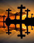 Cross at the sunset and the orange clouds — Zdjęcie stockowe