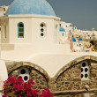 Stock Photo: Flowers and church in Oiat greek island of Santorini