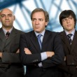 Team of three business men standing pensive — Foto de Stock