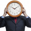 Caucasian man wearing suit holding clock in the head — Foto de Stock