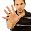 Young man making stop with his hand — Stock Photo #23689579