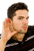Young man with open hand, earing something — Stock Photo