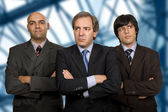Team of three business men standing pensive — Stock Photo