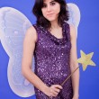 Stock Photo: Young beautiful womdressed as tinkerbell, studio picture