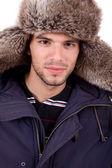 Studio foto van een jonge man gekleed voor de winter — Stockfoto