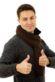 Young casual man going thumbs up in a white background — Stock Photo