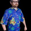 Young happy man with a hawaiian shirt on black background — Stock Photo #23748855