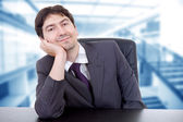 Young business man on a desk at the office — Stock Photo