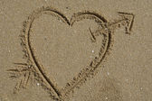 Love message, an heart draw in the sand — Stock Photo