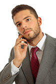 Young business man on the phone, isolated — Stock Photo