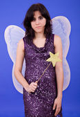 Young beautiful woman dressed as tinkerbell, studio picture — Stock Photo