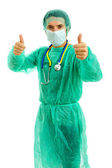 Young male doctor going thumbs up, isolated on white — Stock Photo