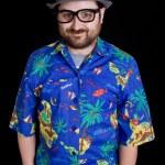 Happy happy man with a hawaiian shirt on black background — Stock Photo #23750009