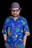 Happy happy man with a hawaiian shirt on black background — Stock Photo