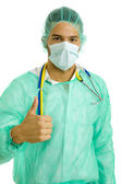 Young male doctor going thumb up — Stock Photo