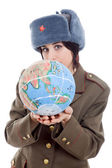 Pretty young woman holding the globe — Stock Photo