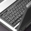 Laptop keyboard detail in a black table — Stock Photo