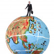 Young business man in the top of a globe — Stock Photo