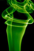Abstract green smoke in a black background — Stock Photo