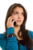 Young woman speaking on the mobile phone — Stock Photo