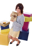 Young shopaholic woman with lots of boxes — Stok fotoğraf