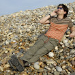 Young man on the beach with cell phone — Foto Stock