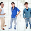 Three young casual men standing - Stock Photo