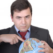 Business man holding a globe — Stock Photo #23806889