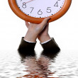 Stock Photo: Woman hands with a clock with reflection