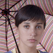 Young brunette girl with umbrella — Stock Photo