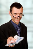 Young business man with money at the office — Stock Photo