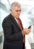 Mature businessman on the phone — Stock Photo