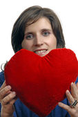 Pretty young woman holding a Valentines heart — Stock Photo
