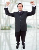 Happy young man with wide open arms — Stock Photo