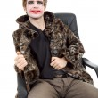 Постер, плакат: Young man dressed as joker