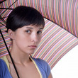 Stock Photo: Young brunette girl with umbrella